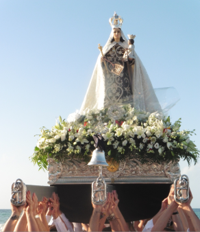 "Members of Marbella´s religious Brotherhood of Nuestra Señora del Carmen, heaved the throne high above their heads to the cries of ""Viva la Virgen del Carmen!"""