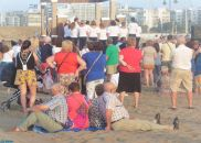 There was an air of informality, as people stood or sat in the sand, gathered around the altar on the beach
