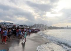 We gathered on the shoreline waiting for the throne bearers to carry the Virgen del Carmen into the sea.