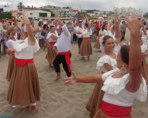 Folkloric dancing in front of the altar